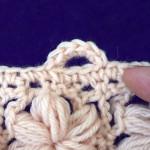 Петли для пуговиц, связанные вместе с обвязкой края